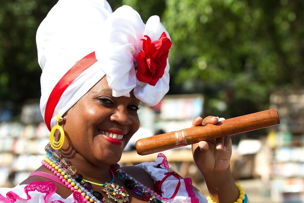 Cuban Woman holding Cigar